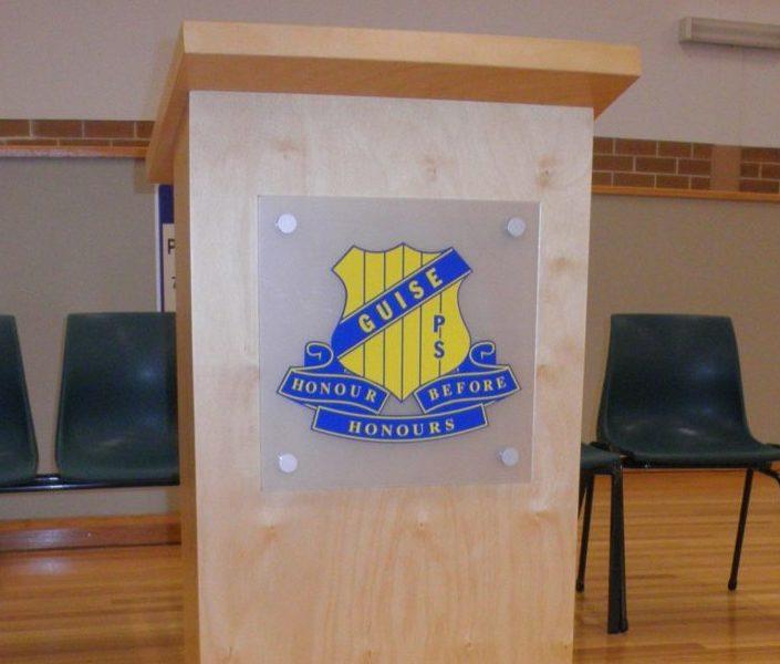 School logo on lectern sign