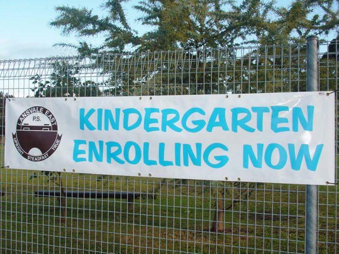 Kindergarten Enrolling Now promotional sign