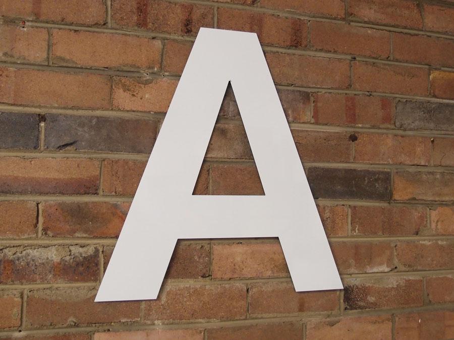 A Block School Sign router cut acp letter